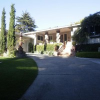 Photo Thumbnail #3: Front yard and driveway. Shown are a...