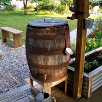 Photo Thumbnail #10: A plastic rain barrel is sitting inside the...