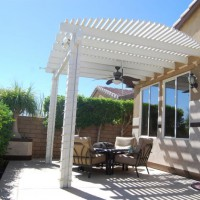 Photo Thumbnail #4: The patio cover supports an outdoor fan.