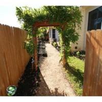 Photo Thumbnail #5: Side yard leading to the pool.  Has raised...