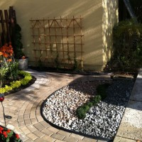 Photo Thumbnail #7: Sealed pavers, added black trim, two color...