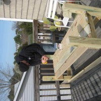 Photo Thumbnail #1: Darrin building me an herb/veggie box from deck...