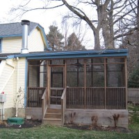 Photo Thumbnail #17: BEFORE: the screened porch that bisects the...