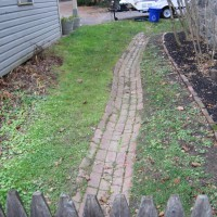 Photo Thumbnail #15: BEFORE: A quaint brick path leading out to the...