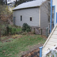 Photo Thumbnail #14: BEFORE: the neighbors garage and a weedy bed