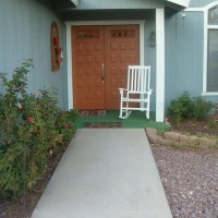 Photo Thumbnail #1: Path leading to front door.  Left of path is...