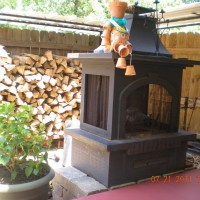 Photo Thumbnail #10: fireplace on additional porch with sitting area