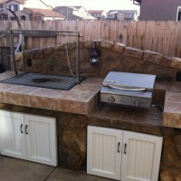 Photo Thumbnail #2: BBQ uses charcoal and wood, table top grill...