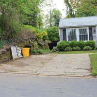Photo Thumbnail #1: Old cracked concrete driveway, retaining wall...