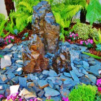 Photo Thumbnail #5: The garden on top features this Basalt fountain