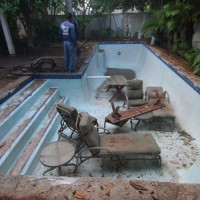 Photo Thumbnail #1: This before photo shows the swimming pool after...