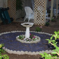 Photo Thumbnail #11: Birdbath is next to the trellis house