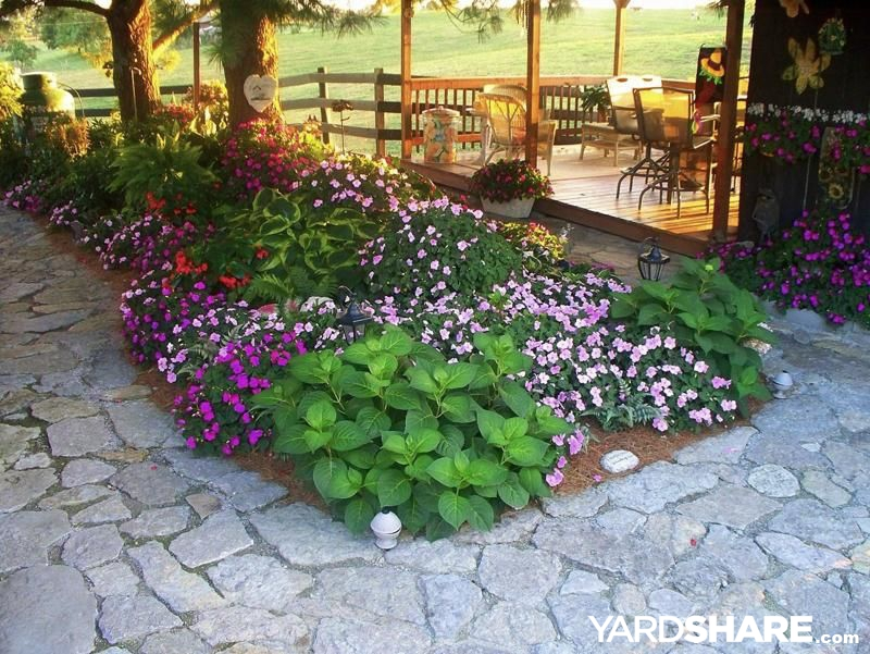 Landscaping ideas country living for Sample backyard designs