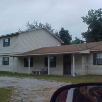 Photo Thumbnail #3: The 2 story section of the house has 2...