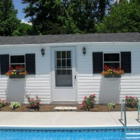 Photo Thumbnail #3: Poolhouse with window boxes, knockout roses and...