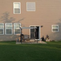 Photo Thumbnail #4: Back of house with small patio, we want to do a...