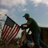 Photo Thumbnail #2: This is our son,Travis, raising the flag at his...