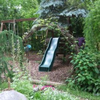 Photo Thumbnail #9: Hobbit hole enterance to the swingset area...