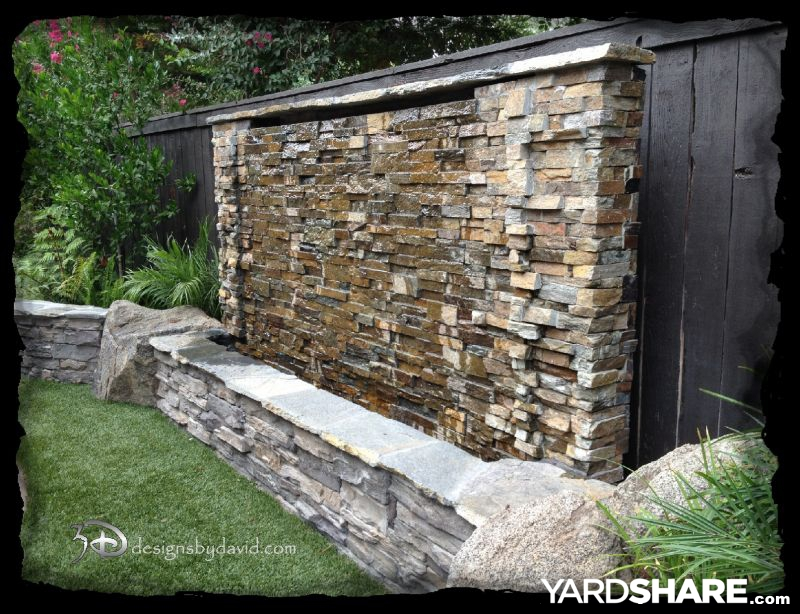 Landscaping ideas tropical paradise for Backyard water wall ideas