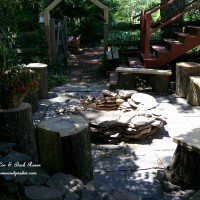 Photo Thumbnail #8: Stone Placed Firepit Using Flagstone and Logs -...