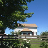 Photo Thumbnail #1: Front of house from road. There is a maple tree...