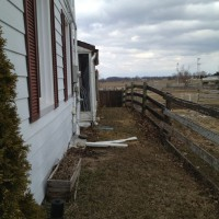 Photo Thumbnail #2: South side of house. We own the field on the...