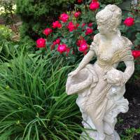 Photo Thumbnail #1: Statue of Lady with Rose background.