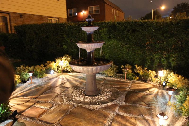 Good landscape lighting makes a night and day difference Water fountain landscaping ideas