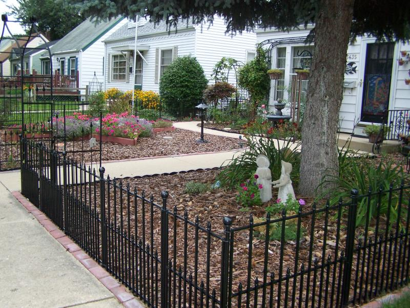 Wrought Iron Fence in Front Yard