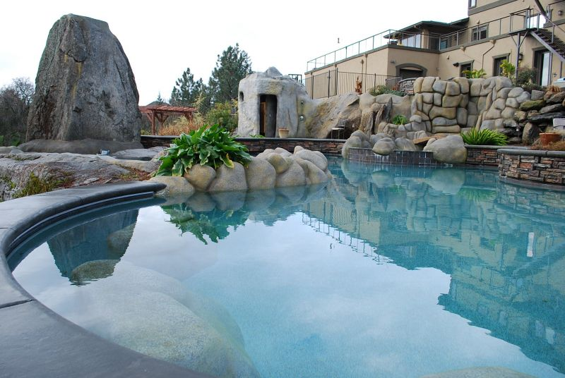 Pool with rocks, water slides, and fountains