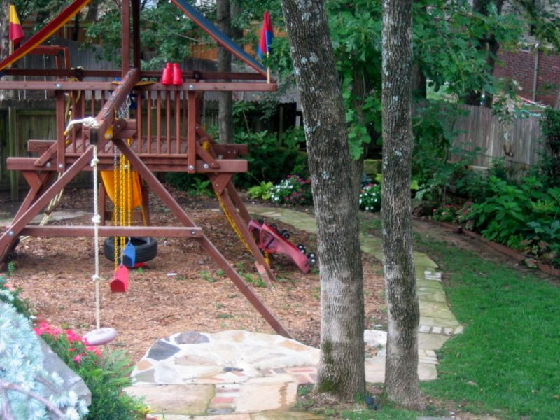playset with mulch and a bike track landscaping ideas