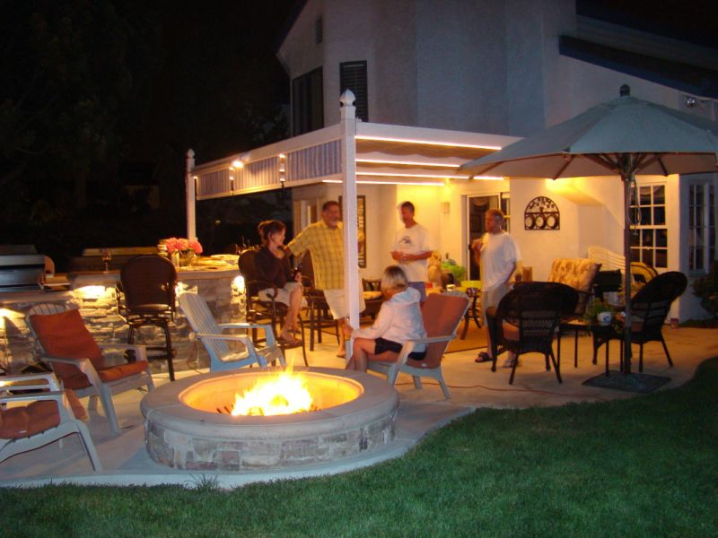 Backyard Firepit adds Lighting Focal Point